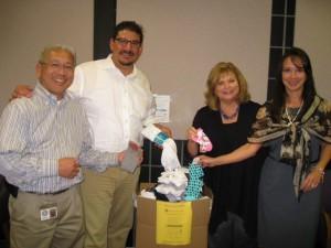 Supervisor Serna and staff collect socks for SOCKtober Drive